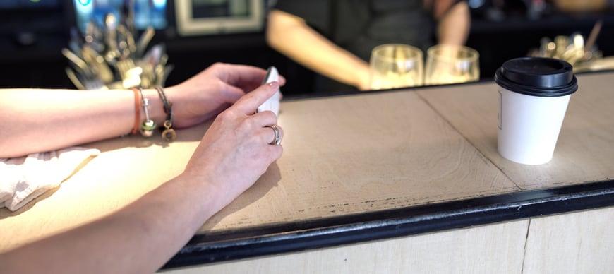 hands-cup-smartphone-bar.jpg